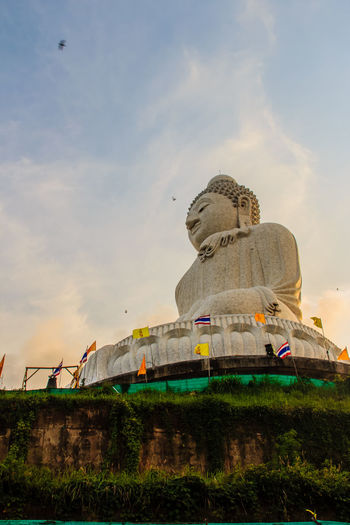 Amazing Massive white marble Buddha statue, the famous tourist attraction on top of hill in Phuket, Thailand. Big Buddha Marble Statue Massive Stone Buddha Architecture Big Buddha Temple Big Buddha Statue Big Buddha, Thailand Building Exterior Built Structure Cloud - Sky Day Giant Buddha History Human Representation Low Angle View Marble Buddha Marble Stone Nature No People Outdoors Sculpture Sky Statue Travel Destinations Worship Places
