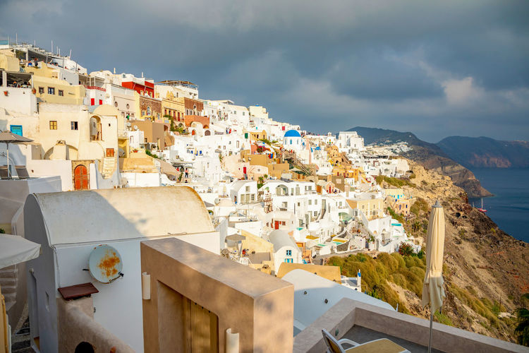 Greece Santorini Oia Thira Building Exterior Architecture Built Structure Building Residential District City Cloud - Sky Sky Nature Town Crowded Water Crowd Mountain High Angle View Sea Day Community TOWNSCAPE Cityscape Outdoors