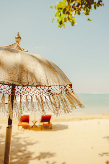 Beach Life Calm Parasols Beach Beauty In Nature Clear Sky Day Focus On Foreground Horizon Horizon Over Water Land Nature No People Outdoors Parasol Plant Sand Scenics - Nature Sea Sky Sunbed Tranquility Tree Umbrella Water