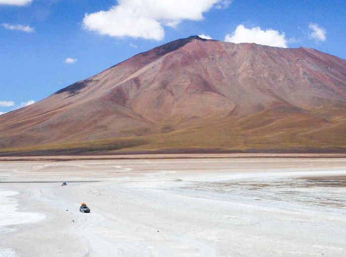 Bolivian desert Arid Climate Beauty In Nature Cloud - Sky Day Environment Idyllic Land Landscape Mountain Mountain Peak Mountain Range Nature No People Non-urban Scene Outdoors Salt Flat Scenics - Nature Sky Snowcapped Mountain Tranquil Scene Tranquility Travel Travel Destinations Winter