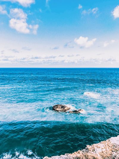EyeEm Selects Sea Sky Horizon Over Water Nature Scenics Water Cloud - Sky Beauty In Nature Outdoors Beauty In Nature Tranquil Scene Wave Puerto Rico Travel Destinations No People Blue Day Tranquility Beach High Angle View Travel Coast Rock - Object Ocean View
