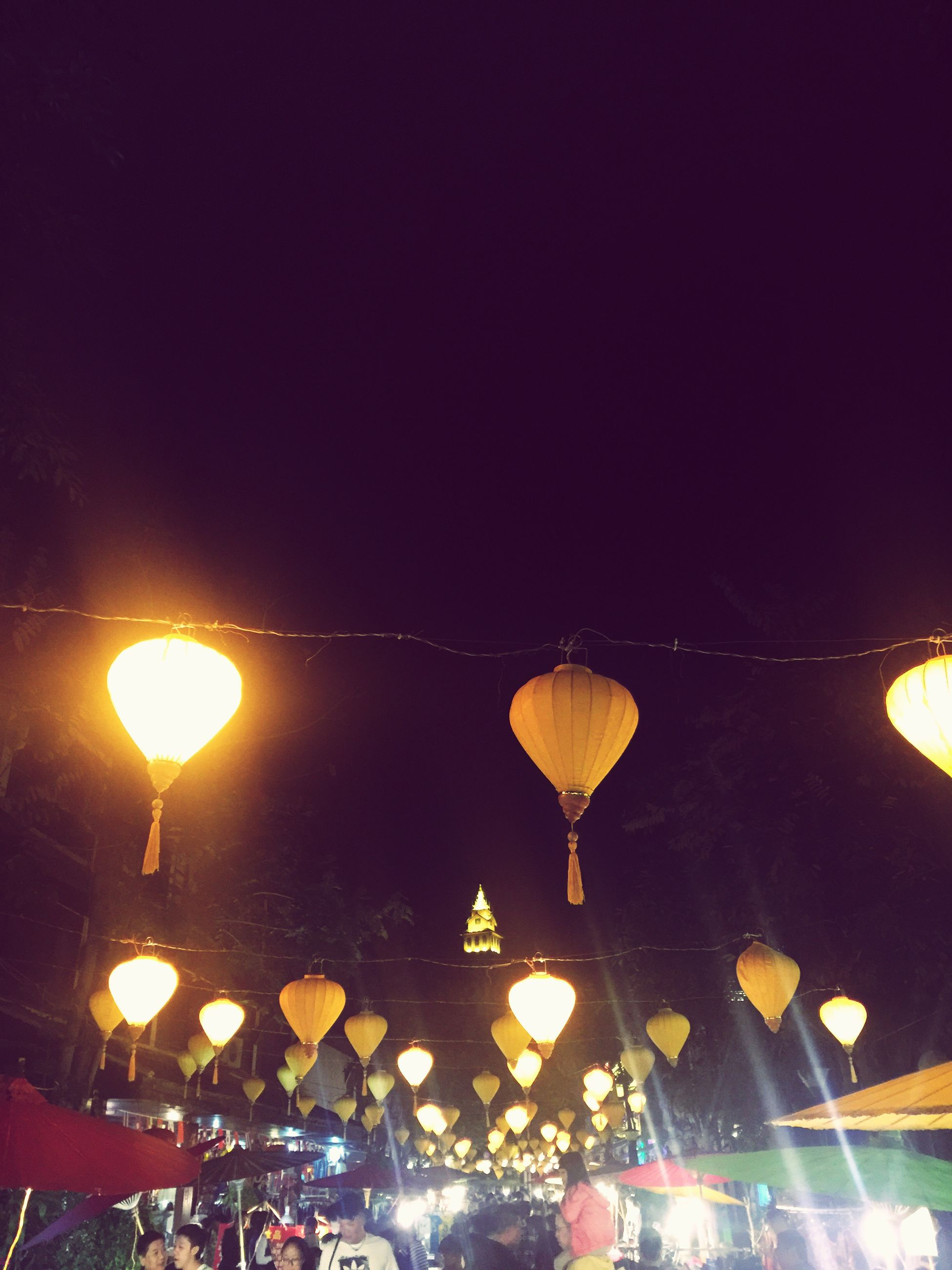 illuminated, lighting equipment, low angle view, hanging, electricity, traditional festival, no people, night, hot air balloon, outdoors