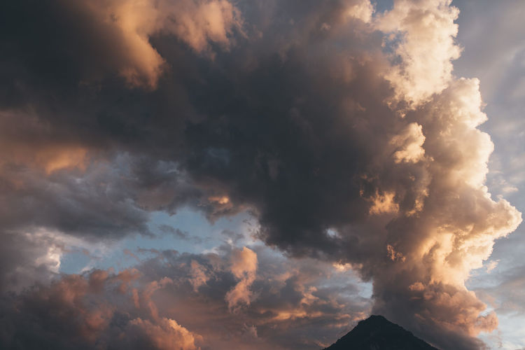 Beauty In Nature Cloud - Sky Cloudscape Dramatic Sky Environment Idyllic Low Angle View Mountain Nature No People Ominous Outdoors Power In Nature Scenics - Nature Sky Storm Storm Cloud Sunlight Sunset Tranquil Scene Tranquility
