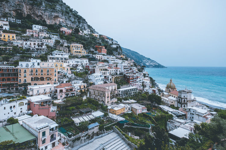 Town of Positano on the Amalfi Coast, Italy. Building Exterior Architecture Sea Built Structure City Water Building Sky Nature Residential District Horizon Horizon Over Water Day No People Land High Angle View Town Cityscape Outdoors TOWNSCAPE Positano Italy Europe Amalfi Coast Blue Water Amazing View Architecture Pastel Colored Colorful Houses