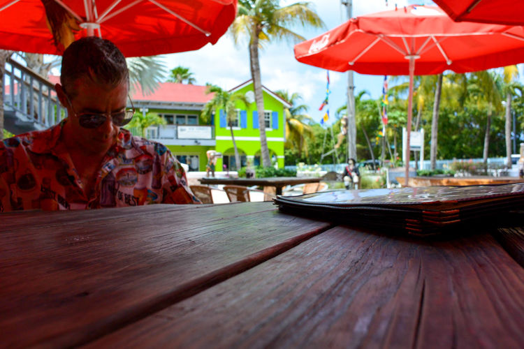 Man sitting at outdoor restaurant