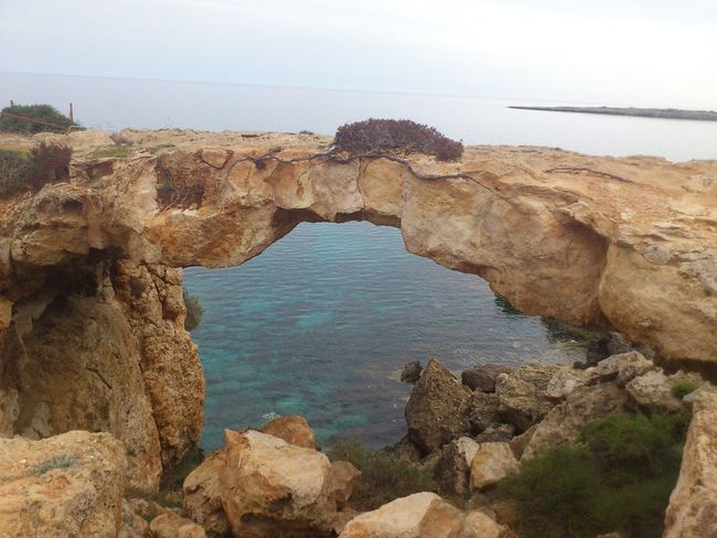 2012 Blue Sea Cyprus Historical Sights Beauty In Nature Blue Sea And Clear Water Day Natural Arch Natural Bridge  Nature No People Outdoors Rock - Object Rock Formation Scenics Sea Sky Tranquil Scene Tranquility Water