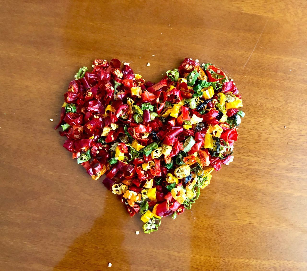 DIRECTLY ABOVE SHOT OF MULTI COLORED HEART SHAPED ON TABLE