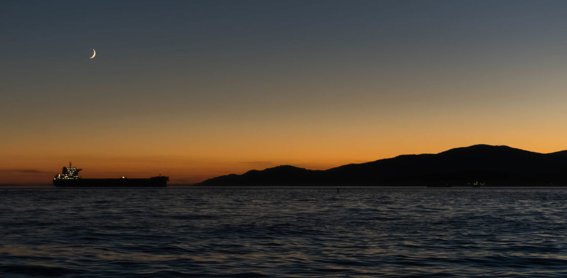 Ships & Sunsets Sunset Scenics Beauty In Nature Mountain Travel Destinations Landscape Sea Tourism Nature Outdoors No People Dusk Tranquil Scene Tranquility Idyllic Silhouette Travel Night Awe Sky Vancouver BC Vancouverisawesome Vancouver Canada