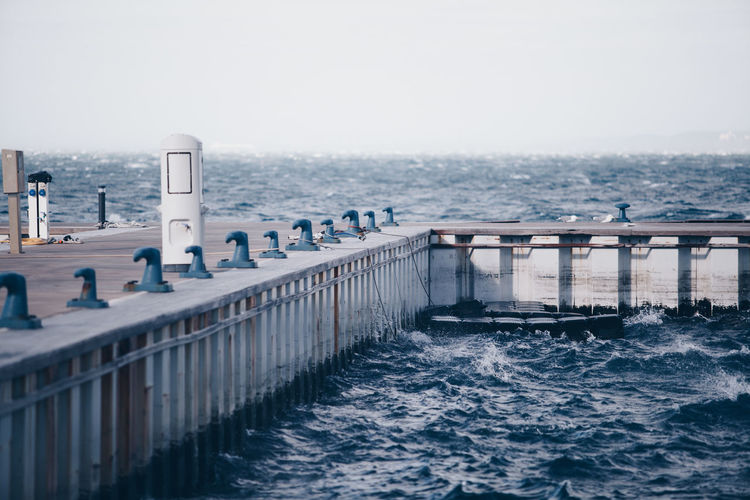 Water Sea Architecture Sky Built Structure Nature Waterfront Day Railing Motion Beauty In Nature Scenics - Nature Transportation No People Pier Outdoors Horizon Clear Sky Bridge Bora Wind