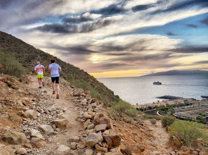 Trail Running Hiking Cloud - Sky Sky Two People Nature Beauty In Nature Full Length Scenics Rear View Outdoors Rock - Object Lifestyles Leisure Activity Mountain Sea Water Real People Vacations Day Togetherness Running Trail Running