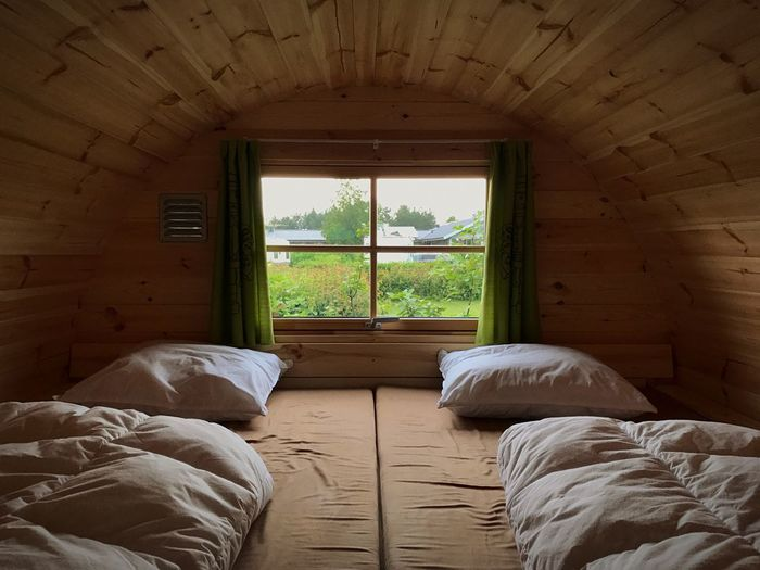 Camping Window Indoors  Home Interior Day No People Architecture Bedroom Bed Built Structure Nature Tree Wooden Cabin Camping Out Camping Holiday Cabin