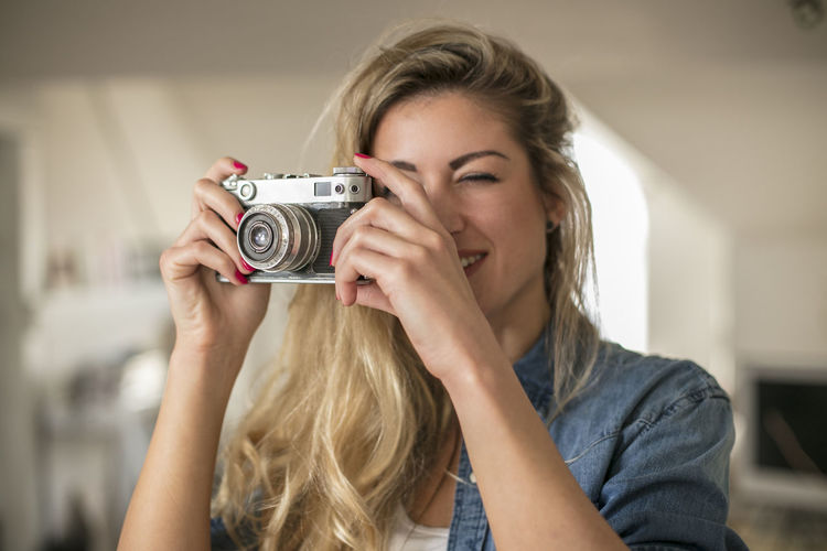 Close-up of young woman photographing