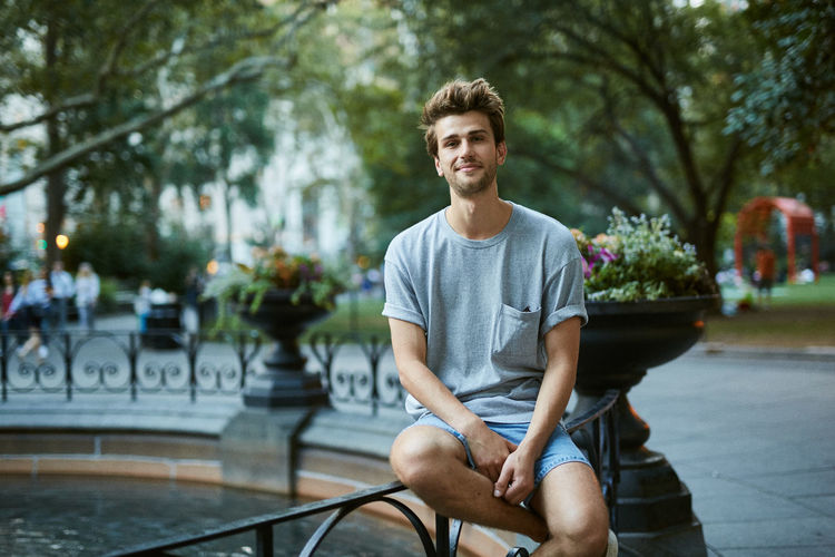 City Looking At Camera Madison Square Park  Man Manhattan New York City Sitting Casual Clothing Dusk Hipster Midtown One Person Outdoors Portrait Smiling Urban Young Adult Young Man