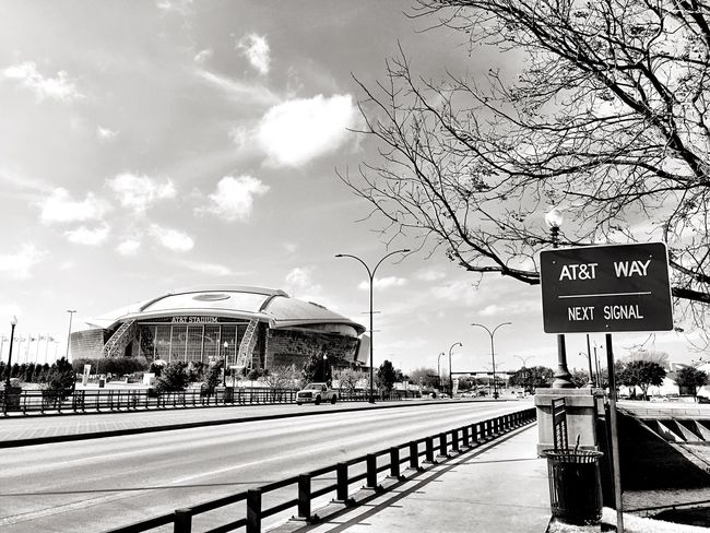 Tree Sky Architecture Text Built Structure Outdoors Building Exterior Communication Bare Tree City Day Cloud - Sky Road No People Road Sign Nature Arlington Texas  Dallas Cowboys NFL Football Stadium Dallas Cowboys Stadium  Monochrome Photography