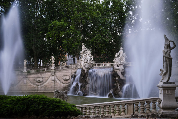 View of fountain against trees
