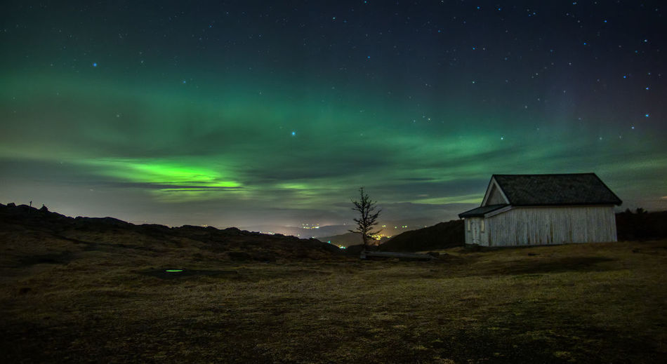 Aurora over Bergen. Night Sky Architecture Built Structure Building Exterior Scenics - Nature Star - Space Green Color Building Beauty In Nature No People Nature Space Tranquil Scene Astronomy Tranquility Land House Environment Field Outdoors Aurora Borealis Northern Lights Long Exposure