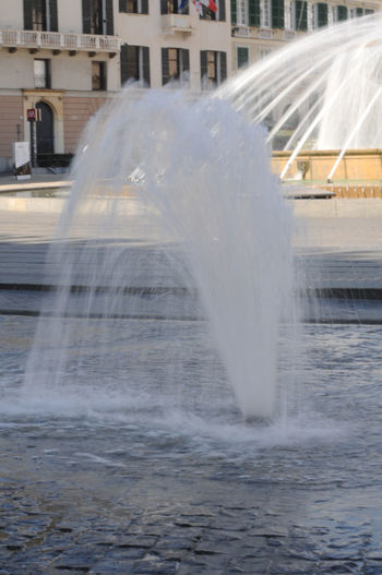 Water splashing on fountain in city