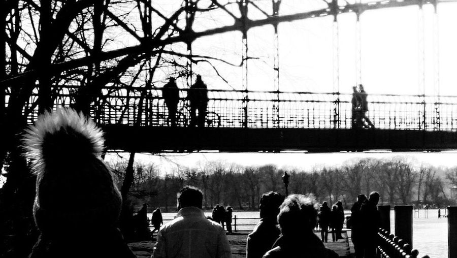 Black And White Blackandwhite EyeEm Gallery EyeEm Selects EyeEm Best Shots Berlin Winter Bridge - Man Made Structure Group Of People Real People Men Crowd Large Group Of People Sky Nature Lifestyles Women Adult Day Fence Clear Sky Boundary Warm Clothing Outdoors Railing Standing Leisure Activity