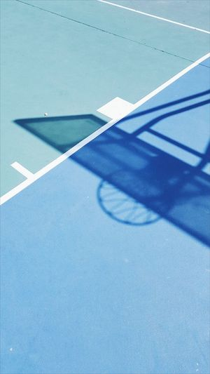 High angle view of shadow on basketball court