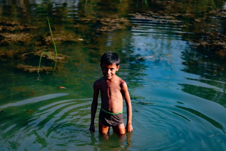 Smiling kid in bluewaters ..and his happiness