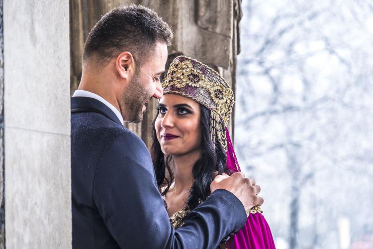 Bride with bridegroom during weeding ceremony