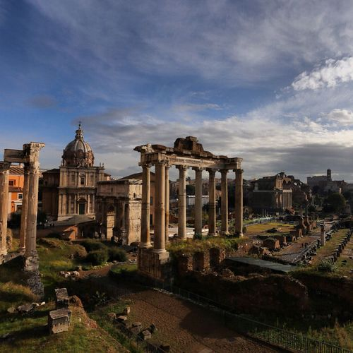 Historic roman forum ruins against sky