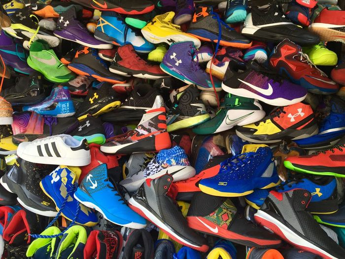 Colourful rubber shoes or sports shoes are displayed at a roadside stall in Zamboanga City in southern Philippines. Rubber Shoes Sports Shoes Sportswear Sports Wear Athletes Foot Athletes Shoes Color Photography Colourful Photography For Sale Zamboanga Sports Beautifully Organized