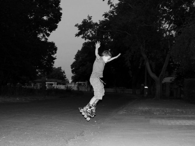 At Night Boy Childhood Jumping Jumpshot Photography In Motion Road Rollerblading Side View Street