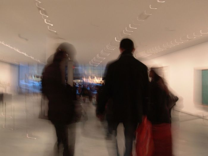walking by the MOMA Motion Blurred Motion Indoors  Walking Adult Rear View Silhouette Three Quarter Length on the move Real People Moma Moma N.Y. Speed