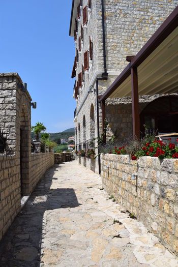 Architecture Brick Building Building Exterior Built Structure Clear Sky Day Footpath History House Montenegro Nature No People Outdoors Plant Residential District Sky Solid Stone Wall Sunlight The Past Ulcinj Wall Wall - Building Feature