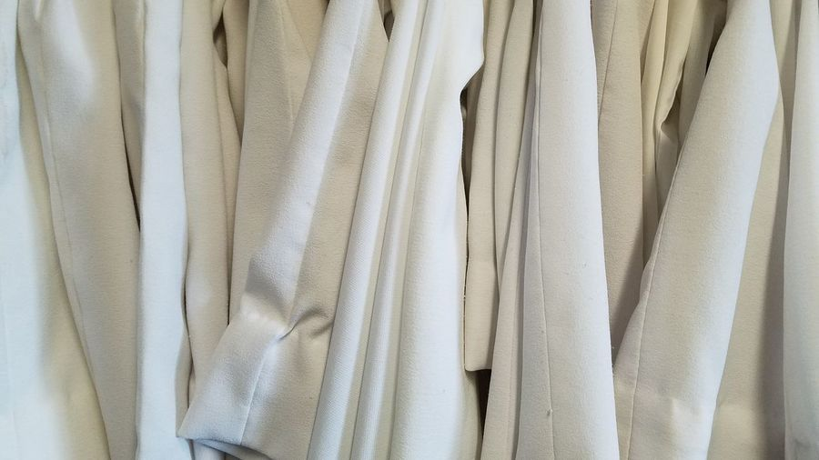 youth choir and music robes Church White purity many pushed together Backgrounds Full Frame Textile Fabric Material Close-up Cloth