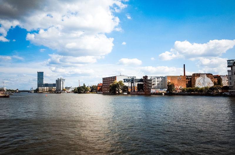 Buildings By Spree River Against Sky
