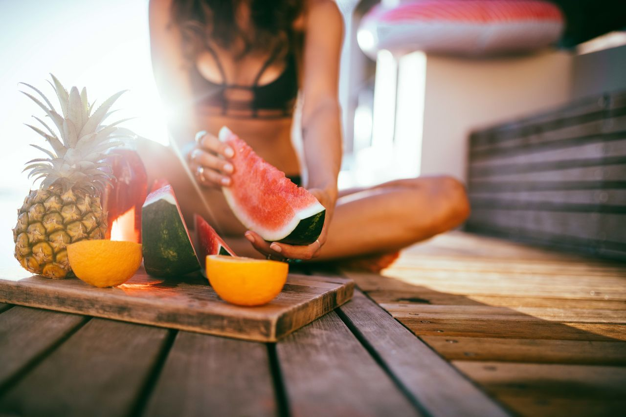 Close-Up Of Woman With Watermelon In Hand