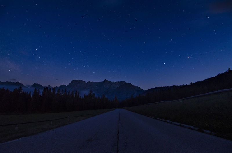 The road to the stars Nightphotography Astronomy Beauty In Nature Blue Clear Sky Galaxy Infinity Landscape Mountain Nature Night Night Sky No People Outdoors Road Scenics Silhouette Sky Space Star - Space Stars The Way Forward Tranquil Scene Tranquility Tree