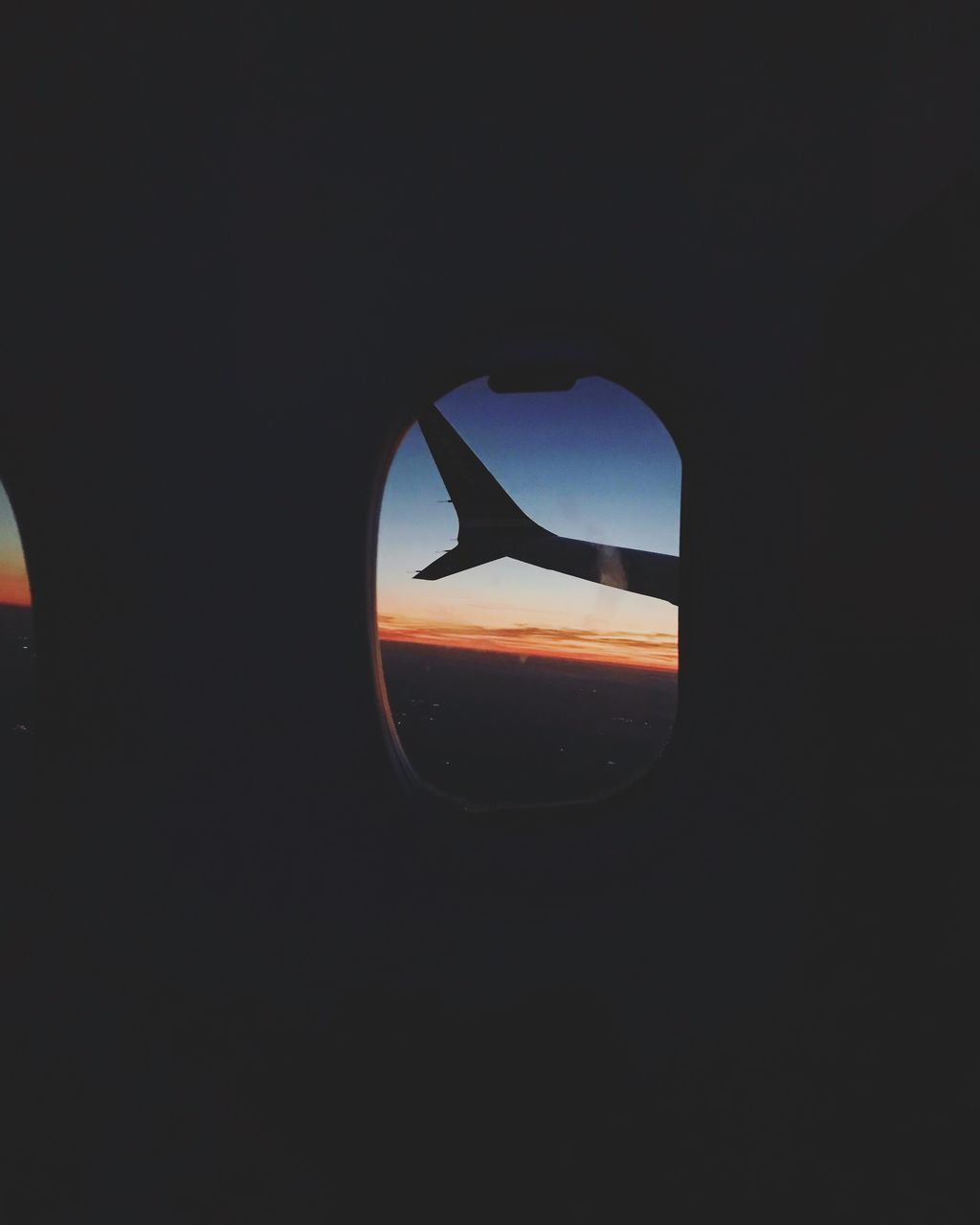 mode of transportation, vehicle interior, transportation, sky, sunset, glass - material, copy space, airplane, transparent, window, public transportation, air vehicle, orange color, one person, silhouette, indoors, land vehicle, illuminated, nature, dark