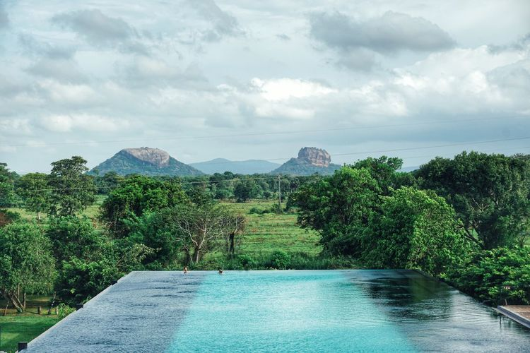 Mountain Tree Scenics Nature Tranquil Scene Tranquility Beauty In Nature Sky Water Day Cloud - Sky No People Idyllic Outdoors Landscape Swimming Pool Green Color Mountain Range Growth Architecture An Eye For Travel