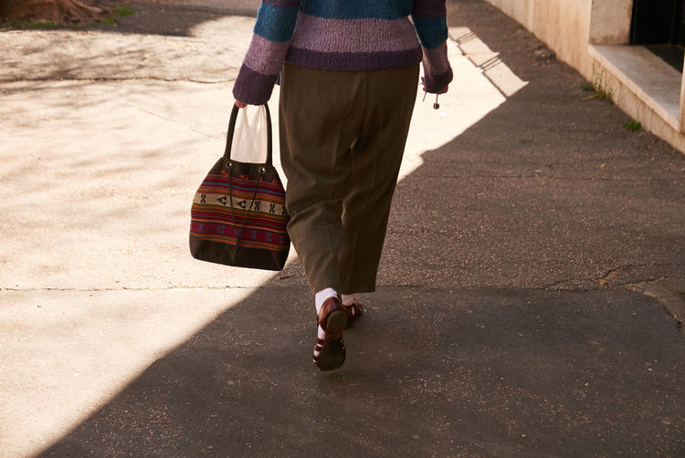 One Person Walking Low Section Day City Holding Carrying Sunlight Men Street Real People Shadow Human Body Part Road Nature Outdoors Bag Rear View Lifestyles Walking Cane The Art Of Street Photography