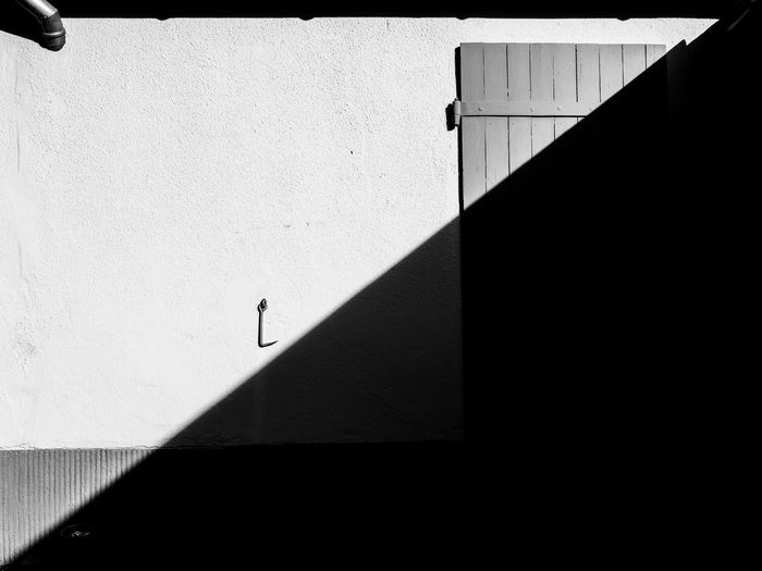 Schattenspiele Sunlight Shadow Day Built Structure Architecture Nature Real People Walking Auto Post Production Filter Wall - Building Feature One Person Outdoors Copy Space Lifestyles Building Exterior Sunny High Angle View Footpath Concrete