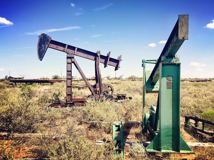 Oilfield boneyard with abandoned pump jacks Abandoned Field No People Sky Day Grass Damaged Oil Pump Outdoors Rusty Oil Well Oil Industry Nature Texas Landscape Pumpjack Petroleum Industry
