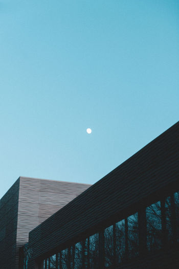 Sky Moon Low Angle View Architecture Built Structure Building Exterior Clear Sky No People Nature Copy Space Outdoors Dusk Space Beauty In Nature Astronomy Full Moon Scenics - Nature Building Half Moon Blue Planetary Moon