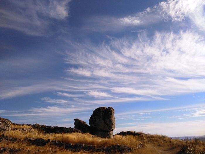 View Of Rock Formation Against Blue Sky