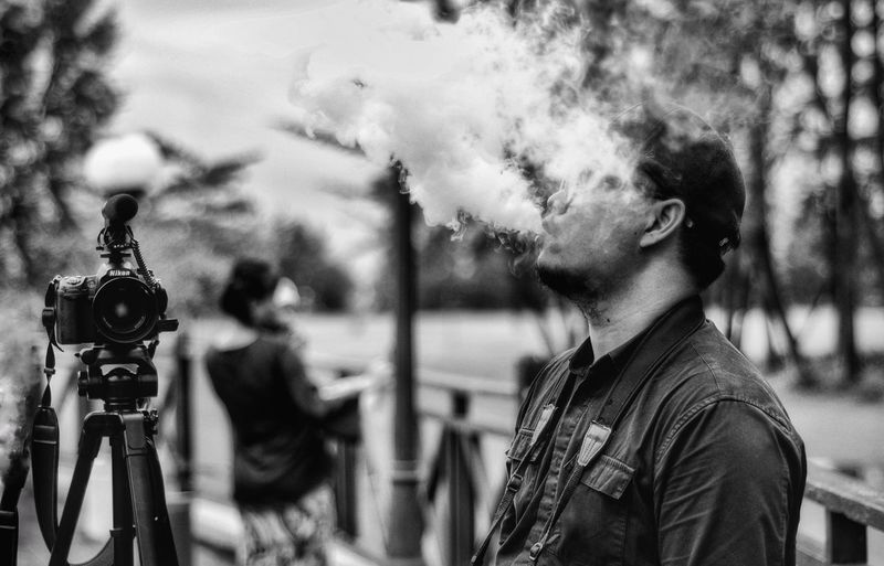 Smoke VapeLife Vape Men Tree Lifestyles One Man Only People Young Adult City Close-up Sky Focus On Foreground Leisure Activity Real People Outdoors Casual Clothing Day Standing One Person