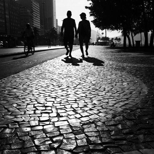 Woman walking on footpath