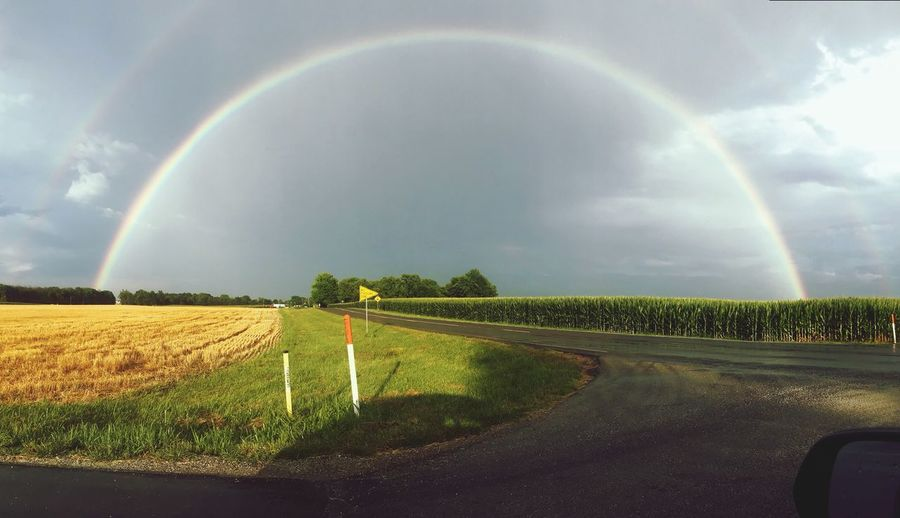 Rainbow Beauty In Nature Nature Land Scenics - Nature Landscape Sky Cloud - Sky Double Rainbow Tranquil Scene No People Environment Rural Scene Water Wet Tranquility Field Rain Idyllic Plant
