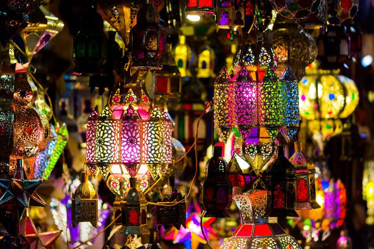 Close-up of illuminated lanterns hanging at market