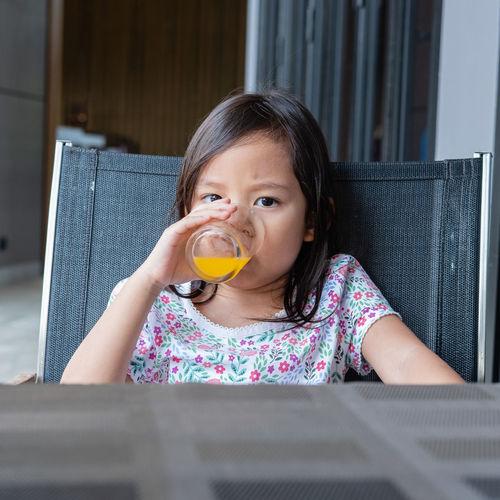 Portrait of girl drinking juice