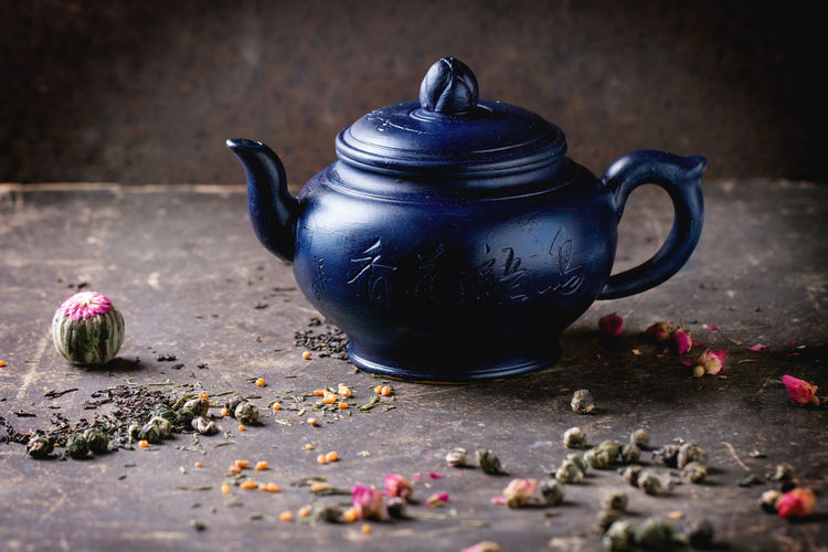 Blue ceramic teapot served with black and green tea lives over dark background Afternoon Tea Asian Style Assortment Ceramic Dark Blue Dark Photography Drink Dry Tea Leaves Food And Drink Green Tea Healthy Eating Healthy Lifestyle Rose Buds Tea Tea - Hot Drink Tea Pot Tea Time Teapot Traditional Culture