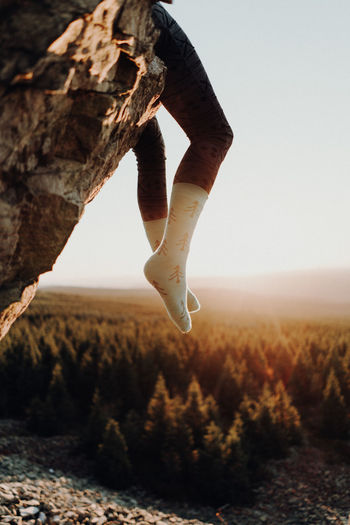 Feet in socks hanging from cliff during suset One Person Real People Nature Sky Human Body Part Day Leisure Activity Low Section Body Part Focus On Foreground Land Human Leg Lifestyles Plant Outdoors Field Tranquility Human Hand Environment Human Foot Human Limb Finger Seunset Cliff Forest