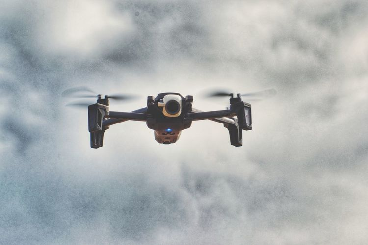 Drone flying against sky