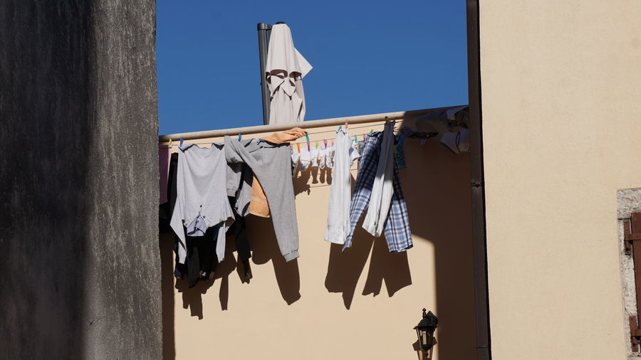 Low Angle View Of Clothes Line Against The Wall